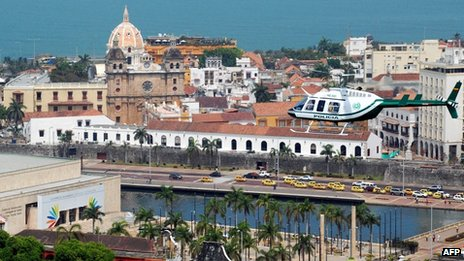 Police helicopter flies over centre of summit venue Cartagena on 10 April 212