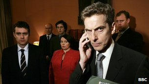 The character of Malcolm Tucker, played by actor Peter Capaldi, in BBC drama The Thick of It, with supporting cast in the background