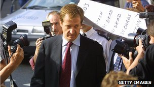 Alastair Campbell walks past a group of protesters and photographers as he arrives at the Royal Courts of Justice in London to testify at the Hutton Inquiry, 19 August, 2003.