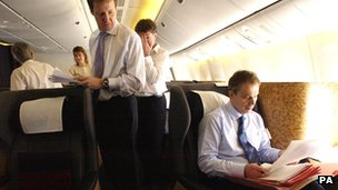 Alastair Campbell (left) with Tony Blair (right) in an aeroplane