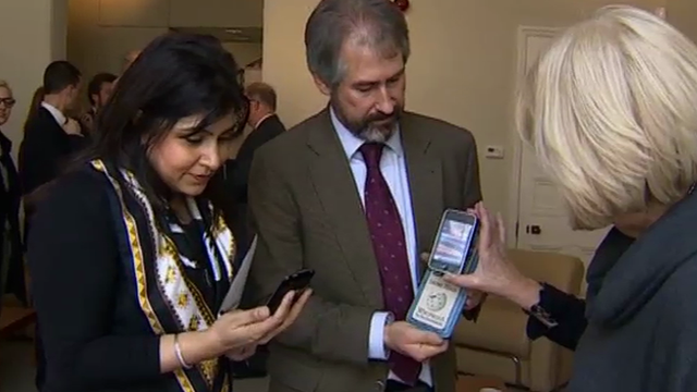 Baroness Warsi, Conservative Party co-chair, views smart phone technology being used by the party