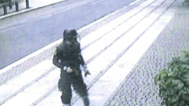 Anders Behring Breivik caught on camera on his way to the island of Utoeya.