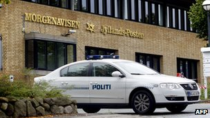 A police car guards the offices of the Jyllands-Posten newspaper in Viby, Denmark, September 2010