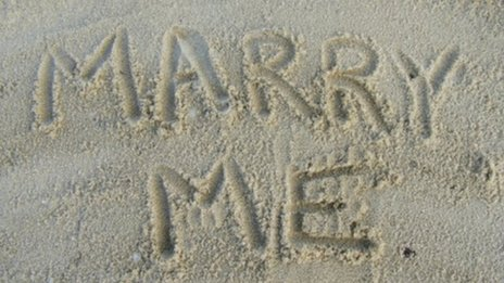 Marry Me written in sand