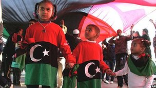 Libyan children dressed in the colours of the country's new flag