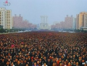 A crowd attends the unveiling of statues of Kim il-Sung and Kim Jong-il in Pyongyang, 13 April