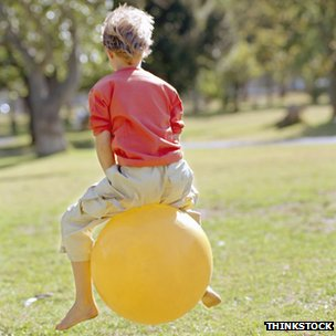 A child on a Space Hopper toy