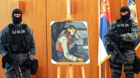Serbian policemen guard Cezanne&#039;s The Boy in the Red Vest