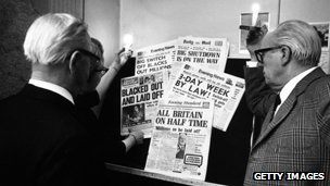 People in London use candles to read newspaper headlines about the continuing miners' strike - 11th February 1972