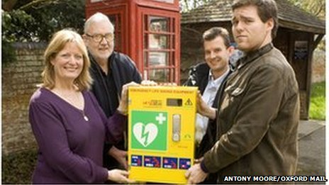 Beth Chesney-Evans pictured with the phone box and, pictured left to right, Crispin Evans, Tom Bowtell, chairman of Long Wittenham Parish Council, and Charles Evans.