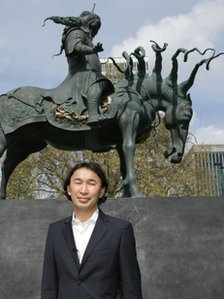 Artist Dashi Namdakov with the statue
