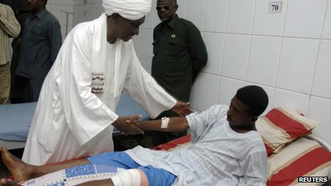 Sudan's First Vice President Ali Osman Taha visits a wounded soldier in Khartoum, 13 April