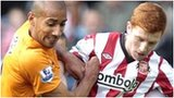 Karl Henry (left) tussles with Jack Colback of Sunderland