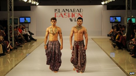 Modelspresent creations by Pakistani designer Arsalan and Yahseer on the third and last day of the Islamabad Fashion Week at the Pak-China Friendship center in Islamabad on April 12, 2012.