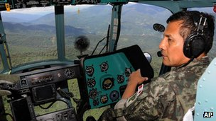 Peru's President Ollanta Humala takes part in a military operation to search for a group of workers abducted by Maoist Shining Path guerrillas