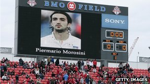 Fans in Toronto, Canada, hold a minute's silence before the MLS game against Chivas USA