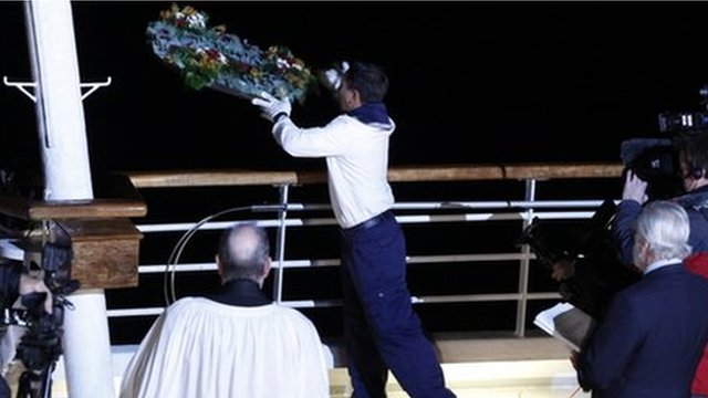 A wreath being thrown off MS Balmoral
