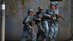 Police take cover in Kabul, 15 April