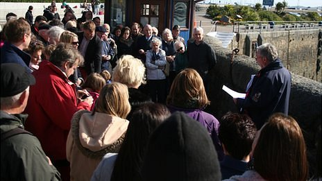 Crowd gather for unveiling of Guernsey Titanic plaque
