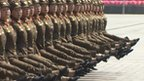 Female soldiers goose step through North Korea