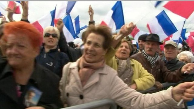 French people wave flags