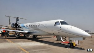 A Legacy 650 Embraer aircraft stands on the tarmac at the India Aviation 2012 show at Begumpet Airport in Hyderabad on March 2012
