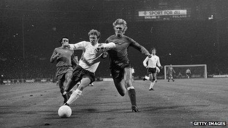 English footballer Colin Bell beats Poland's Jerzy Gorgon in 1973 match