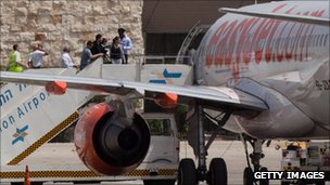 Passengers board a plane, which flew in Pro-Palestinian activists, before in heads back to Belgium on Sunday
