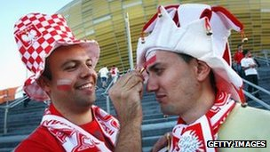 Polish football fan painting second fan's face