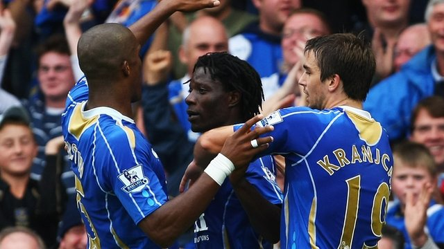 Portsmouth's Sylvain Distin, Benjani and Niko Kranjcar