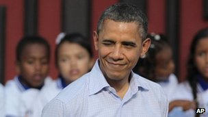 Obama winks during an arrival ceremony in Cartagena, Colombia 15 April 2012