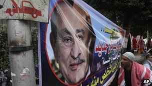 Poster showing half the face of Omar Suleiman and half the face of Hosni Mubarak