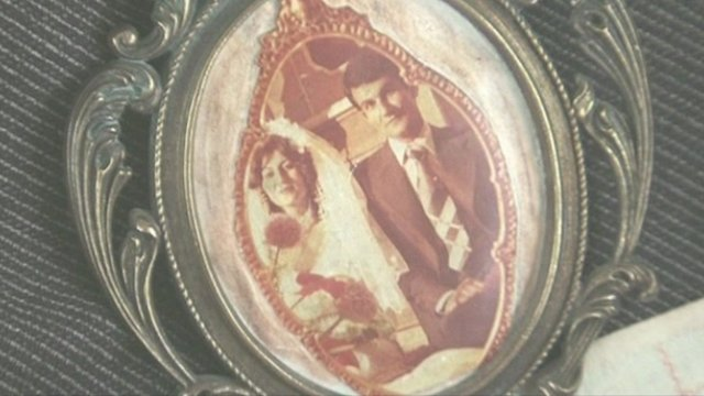 Framed wedding photo of an imprisoned couple. 