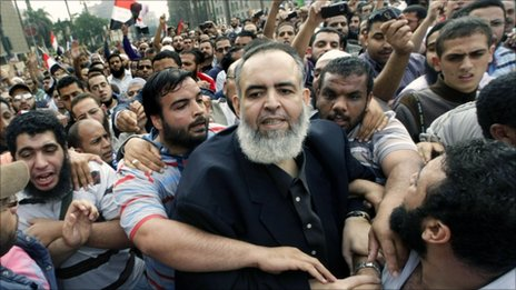 Salafist cleric, Hazem Abu Ismail, in a crowd of his supporters in Tahrir Square