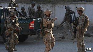Afghan soldiers patrol a street