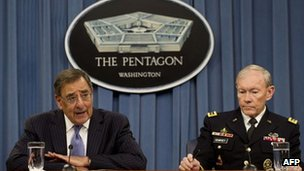 Leon Panetta and General Martin Dempsey speak to reporters on 16 April 2012