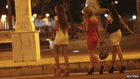 Prostitutes walk a street of the old city in Cartagena, Colombia 14 April 20212