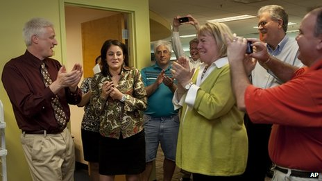 Patriot-News reporter Sara Ganim (second left) and colleagues celebrate their Pulitzer Prize at their office in Harrisburg, Pennsylvania on 16 April 2012