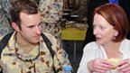 File photo (October 2010) of Australian PM Julia Gillard with an Australian soldier in Afghanistan