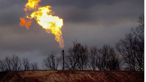 A gas flare burns at a fracking site