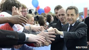Nicolas Sarkozy shakes hands with supporters at a mass rally in the Place de la Concorde, Paris (15 April 2012)