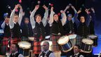 The Titanic Drums perform at a commemorative concert at Belfast's Waterfront Hall