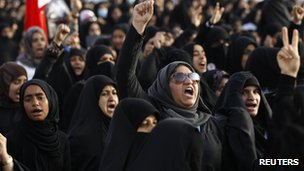 Anti-government protesters shout anti-government slogans as they march in a procession to visit the grave of Ismael Abdulsamad in the village of Salmabad, south of Manama, April 16, 2012