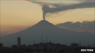 View of Popocatepetl over skyline of Puebla, Mexico