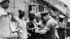 "Soldiers of Britain""s Royal Inniskilling Fusiliers check the identity of men during a raid on parts of nairobi, Kenya"