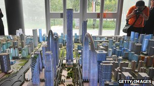 Investors looking at a model of Beijing's future skyline