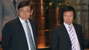 Chairmen and Managing Directors of Sun Hung Kai Properties Raymond Kwok (L) and Thomas Kwok (R) 