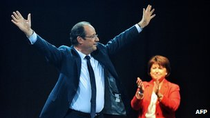Francois Hollande is applauded by ally Martine Aubry at a rally in Lille, northern France, 17 April