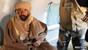 Saif al-Islam Gaddafi sitting in a plane in Zintan after his capture (November 19, 2011)
