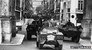 Military vehicles patrol the streets after the 1974 coup